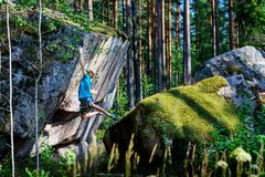 Male climber climbing overhanging rock. Boudering. Outdoor active lifestyle stock photo