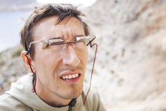 Male climber wearing belay glasses while watching his partner climbing Royalty Free Stock Image