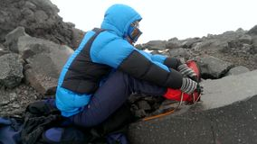 Male climber wears crampons on boots stock video