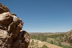 Male climbing on cliffs. Rock Climbing on cliffs above outback australia Stock Photography