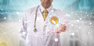 Male Clinician Initiating An AI APP In A Network. Unrecognizable male clinician initiating an AI app in a computing network. Healthcare technology concept for Stock Image