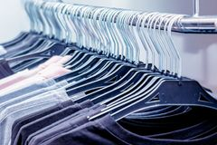 Male clothing on hanger at the modern shop boutique_. Male clothing on hanger at the modern shop boutique Royalty Free Stock Photos