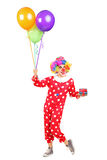 Male clown with a bunch of balloons Royalty Free Stock Photos