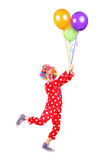 Male clown holding balloons and flying Royalty Free Stock Images