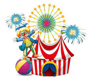 A male clown playing outside the tent Stock Images