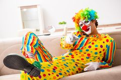 The male clown preparing for perfomance at home. Male clown preparing for perfomance at home royalty free stock image