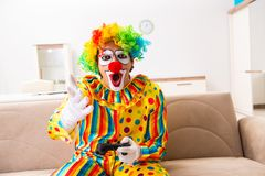 The male clown preparing for perfomance at home. Male clown preparing for perfomance at home stock images
