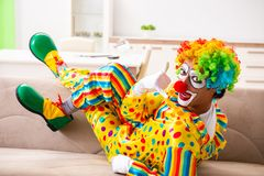 The male clown preparing for perfomance at home. Male clown preparing for perfomance at home stock photos