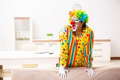 The male clown preparing for perfomance at home. Male clown preparing for perfomance at home royalty free stock photography