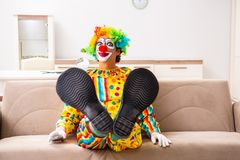 The male clown preparing for perfomance at home. Male clown preparing for perfomance at home royalty free stock images
