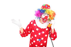 Male clown talking on a vintage telephone Royalty Free Stock Photos