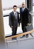 Male co-workers posing together in corner Stock Photography