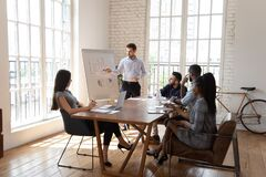 Free Male Coach Make Whiteboard Office Presentation To Diverse Employees Stock Photo - 169070830