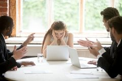 Male colleagues pointing fingers at upset female boss on meeting. Tired sad women leader experiencing gender discrimination at work, businessmen blaming stock photos