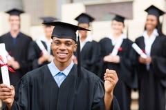 Male college graduate. Happy african american male college graduate at ceremony Stock Image