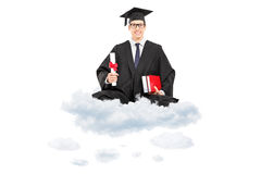 Male college graduate holding diploma and books seated on cloud Royalty Free Stock Images