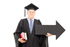 Male college professor holding big black arrow pointing right Stock Image