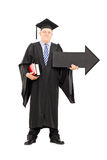 Male college professor holding big black arrow pointing right Royalty Free Stock Photos