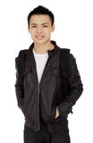 Male College Student. An Asian male college student with jacket and backpack against a white background Stock Images