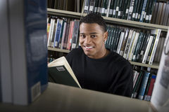 Male College Student In Library Stock Images