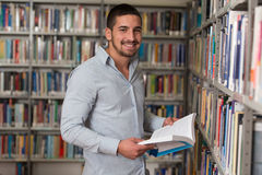 Male College Student In A Library. A Portrait Of An Caucasian College Student Man In Library - Shallow Depth Of Field Stock Photography
