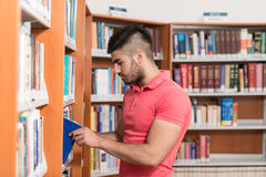 Male College Student In A Library. Portrait Of A College Student Man In Library - Shallow Depth Of Field Stock Image