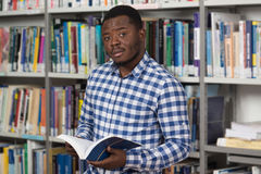 Male College Student In A Library. Portrait Of A College Student Man In Library - Shallow Depth Of Field Stock Photos