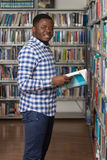 Male College Student In A Library. Portrait Of A College Student Man In Library - Shallow Depth Of Field Royalty Free Stock Photo