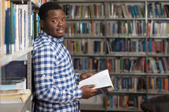Male College Student In A Library. Portrait Of A College Student Man In Library - Shallow Depth Of Field Stock Photo