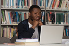 Male College Student Stressed About His Homework Royalty Free Stock Images