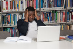 Male College Student Stressed About His Homework Stock Photo