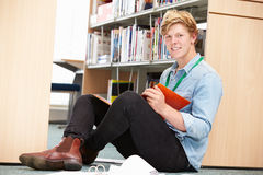 Male College Student Studying In Library Royalty Free Stock Photography