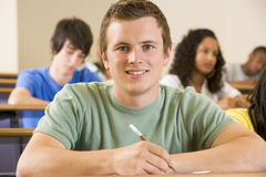 Male college student in a university lecture hall.  Stock Photography