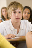 Male college student in a university lecture hall.  Royalty Free Stock Photos