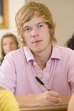 Male college student in a university lecture hall Royalty Free Stock Photo
