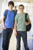 Male college students standing in university. Corridor Royalty Free Stock Photography