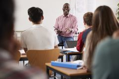 Male College Tutor With Digital Tablet Teaching Class Royalty Free Stock Photos