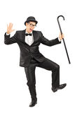 Male comedian dancing with a cane Stock Photos
