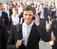 Male commuter in crowd. Using phone royalty free stock photo