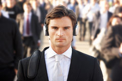 Male commuter in crowd Stock Photo