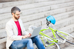 Male commuter in London working with laptop computer Stock Photography