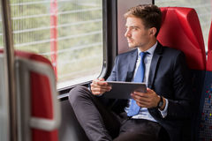 Male commuter traveling by train Royalty Free Stock Photos