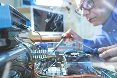 Male Computer Technician repairing Hardware throw the window image Royalty Free Stock Images