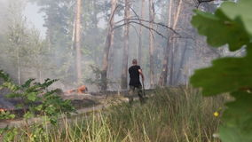 Male conscript firefighter at DVRZ forest fire stock footage