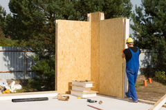 Male Construction Worker Building House Wall Royalty Free Stock Photo