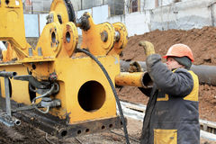 Male construction worker on a construction site work repairing s Stock Images