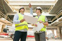 Male construction worker and engineer at the construction site. Building, development, teamwork and people concept.  stock photography