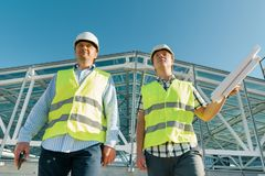 Male construction worker and engineer at the construction site. Building, development, teamwork and people concept.  stock images