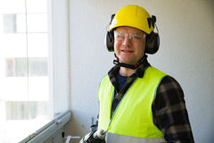 Male construction worker in hard hat drilling concrete wall Royalty Free Stock Photography