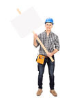 Male construction worker holding a blank sign Stock Photo